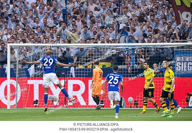 15 April 2018, Germany, Gelsenkirchen:Soccer, German Bundesliga, FC Schalke 04 vs Borussia Dortmund at the Veltins Arena: Schalke's Naldo (l) celerbates his...