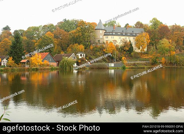 18 October 2020, Saxony-Anhalt, Stiege: The landmark of the picturesque village of Stiege in the Harz region is the former hunting lodge of the Counts of...