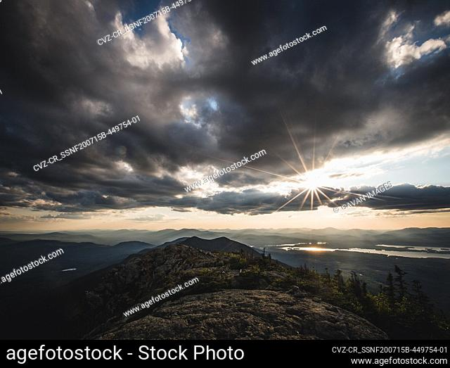 Sun sets over Appalachian Trail and mountains and lakes of Maine