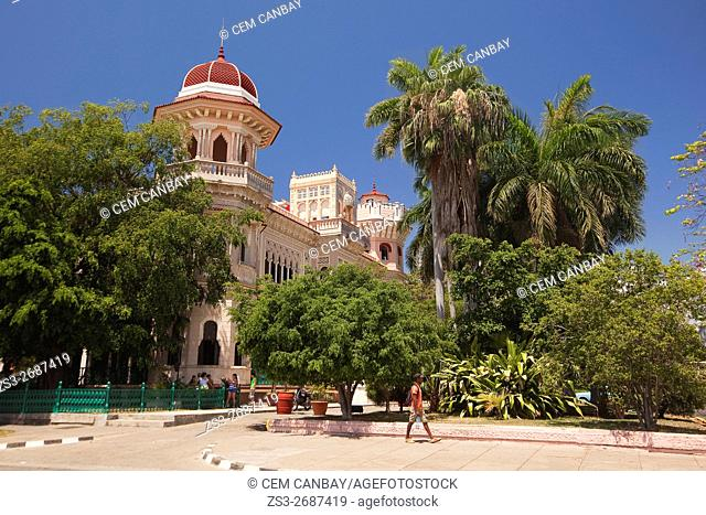 Tourists in front of the Palacio de Valle-Moorish style palace, at Punta Gorda district, Cienfuegos, Cuba, Central America