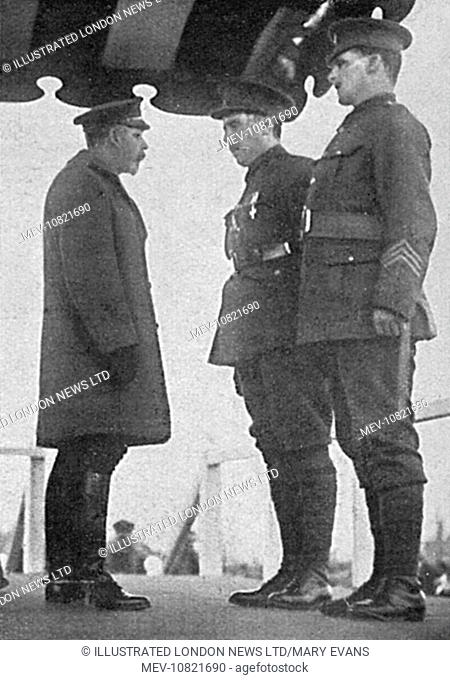 Captain Angus Buchanan receiving the VC and Military Medal from King George V at the Bristol investiture. He was led to the platform