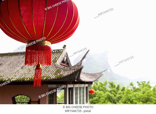 Red lantern hanging in front of a temple, Yangshuo, China
