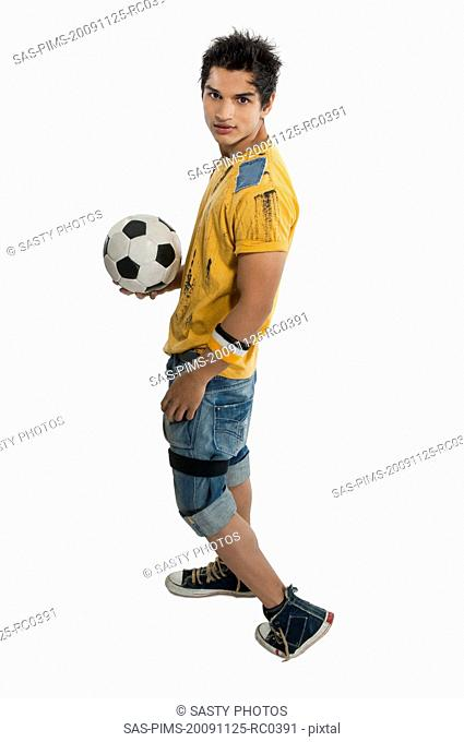 Portrait of a man holding a soccer ball