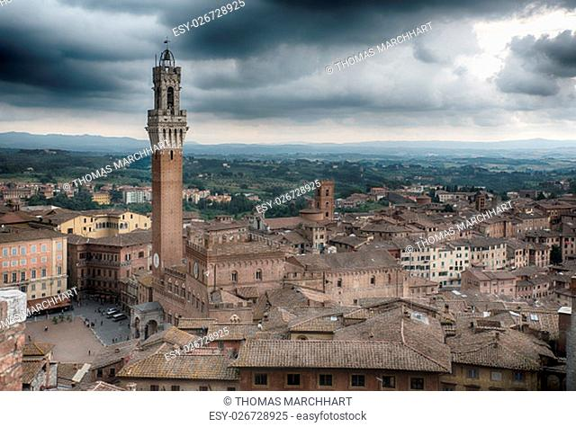 Piazza del Campo with the Torre del Mangia and the Palozzo Publico in Siena, Tuscany, Italy on a stormy day