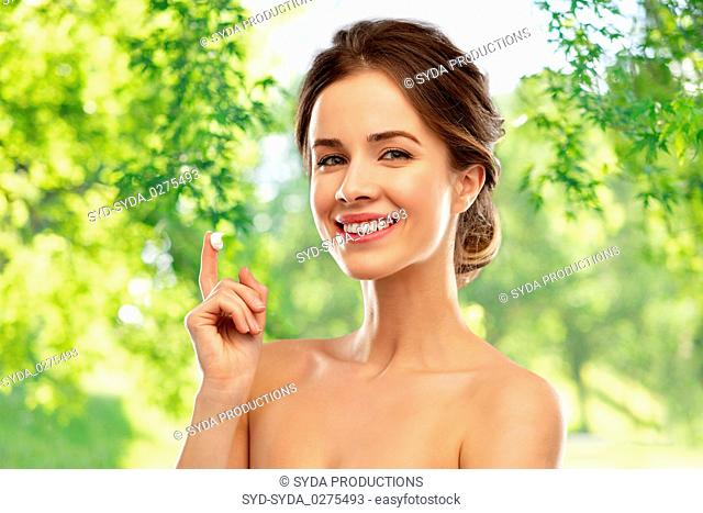 happy young woman with cream on her finger