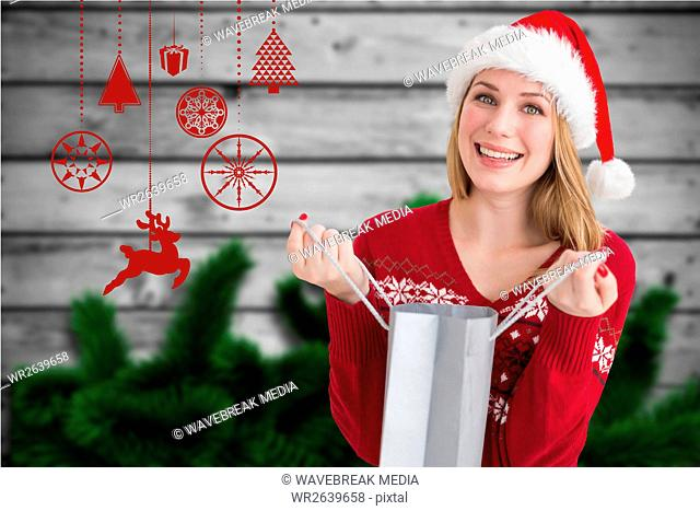 Beautiful woman in santa hat holding a shopping bag