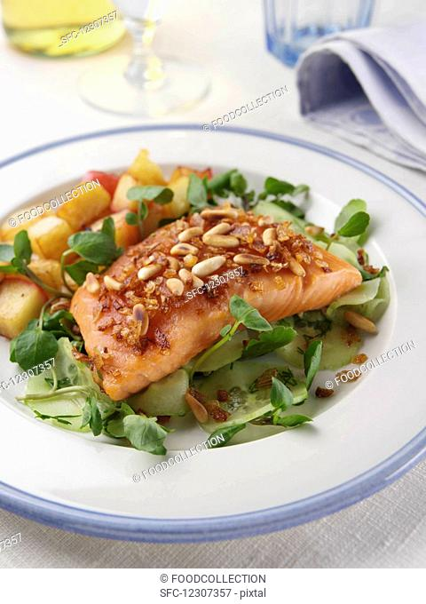 Single serving of smoked salmon tail with sauteed potatoes and apples editorial food