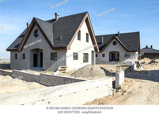 New build houses. Black roof, mountain