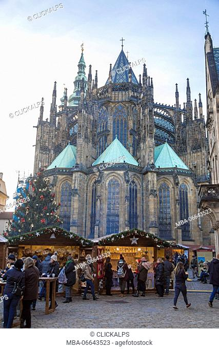 Tourists at the Christmas markets facing the Cathedral of Saint Vitus Old Town Square Prague Czech Republic Europe