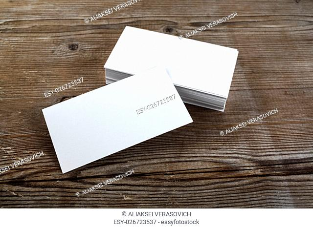 Photo of blank business cards on a wooden background. Template for ID