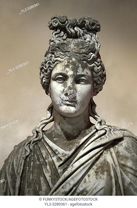 Roman statue of a woman. Marble. Perge. 2nd century AD. Inv no 2015/186. Antalya Archaeology Museum; Turkey. Against a warm art background