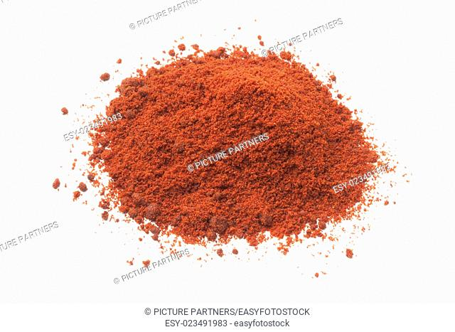 Heap of paprika powder on white background