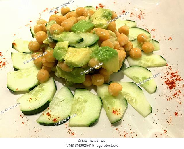 Salad made of chickpeas, avocado, cucumber, olive oil and paprika