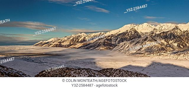 Ben Ohau Range dawn panorama, cloud covers Lake Pukaki, from Burnett Mountains, edge of Aoraki / Mount Cook National Park, Canterbury