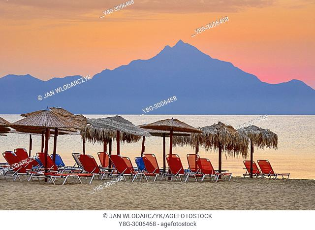 Sunbeads and sunshade on the beach, Mount Athos in the background, Halkidiki, Sithonia, Greece