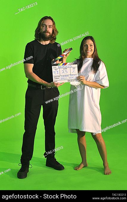 MEXICO CITY, MEXICO - OCTOBER 26: The actor, Alex Crusa and actress Carla Hernández pose with the Clapperboard from the film (Nudus) by director Gibran Bazanon...