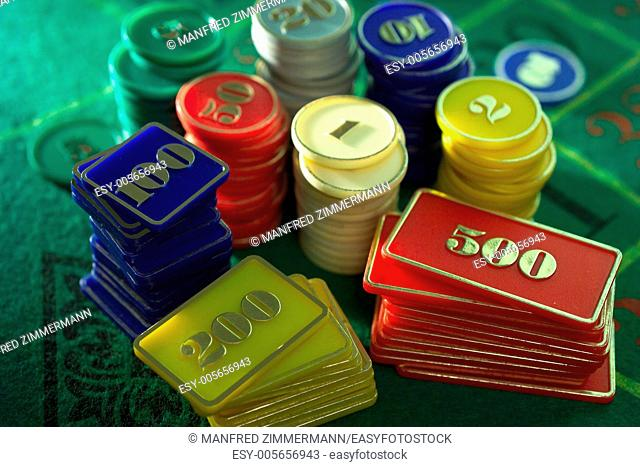 A collection of roulette or poker chips