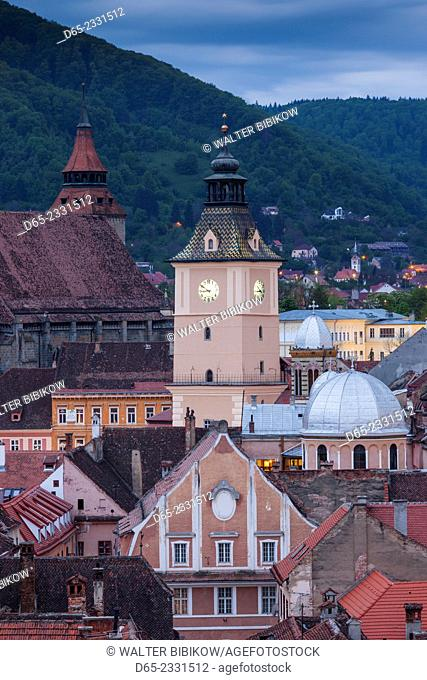 Romania, Transylvania, Brasov, elevated city view with Black Church and Town Hall tower, evening