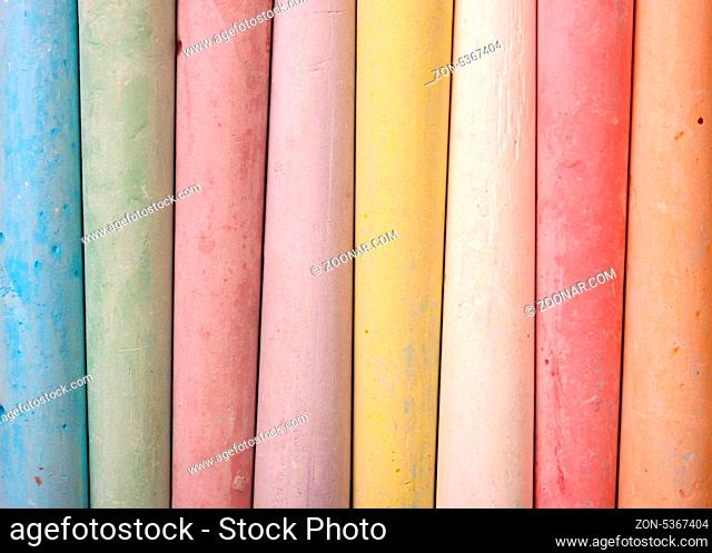 Close up of multicolored chalk sticks together