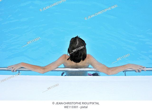 13 year old boy in a swimming pool