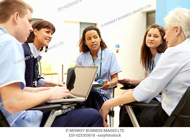 Members Of Medical Staff In Meeting Together