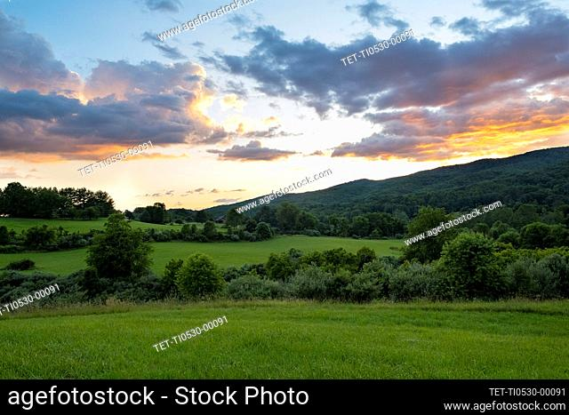 USA, Sunset over green mountains