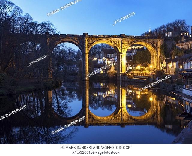 Railway viaduct over the River Nidd floodlit at dusk Knaresborough North Yorkshire England