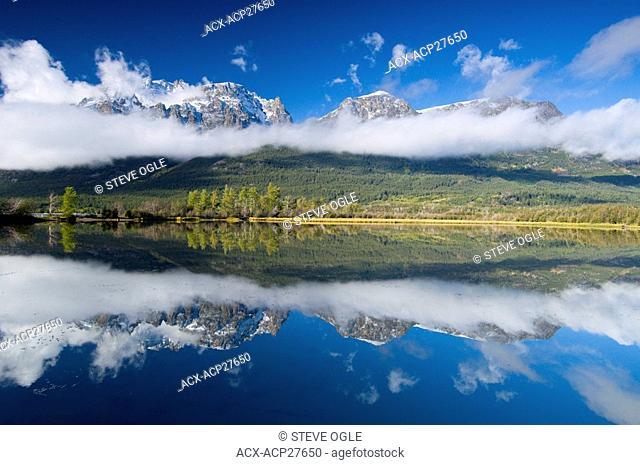 The Niut Range is reflected in the lagoon near the shores of Tatlayoko Lake, British Columbia Coast Mountains, Canada