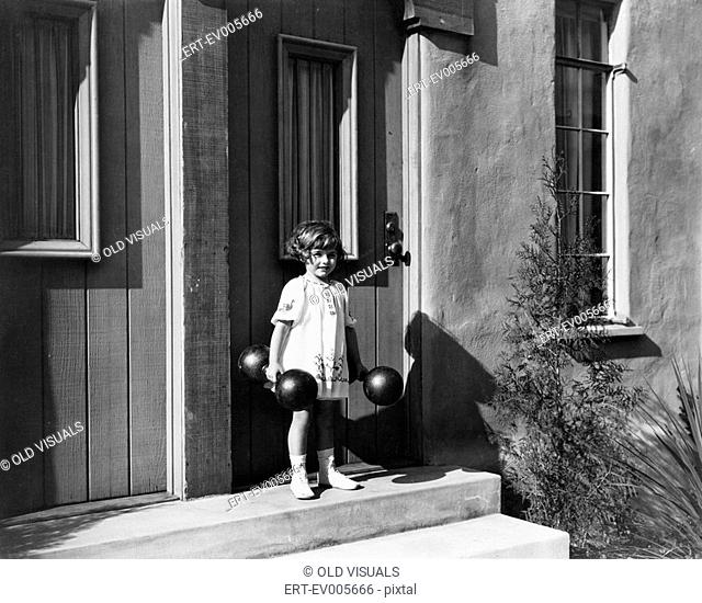 Girl holding dumbbells and standing in front of a door All persons depicted are not longer living and no estate exists Supplier warranties that there will be no...