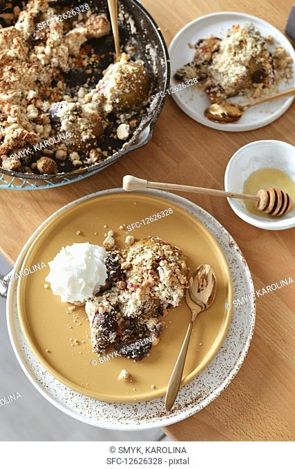 Baked fruit under crumble with whipped cream