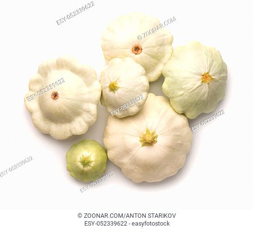 Top view of ripe white pattypan squashes isolated on white