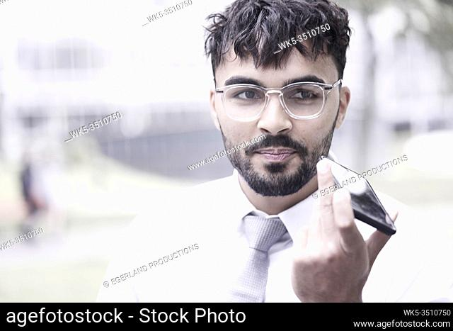 obstinate businessman on the street, talking on phone
