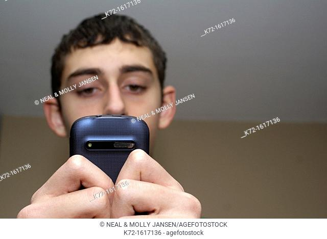 Teenager reading a text message