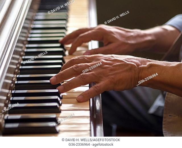 Hands of man playing piano in Providence, Rhode Island, United States