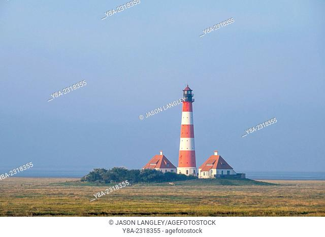 Westerhever Lighthouse at sunrise, built in 1906, Westerhever, Nordfriesland, Schleswig-Holstein, Germany
