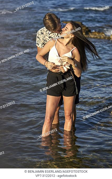 Couple standing in sea, love. Chersonissos, Crete, Greece