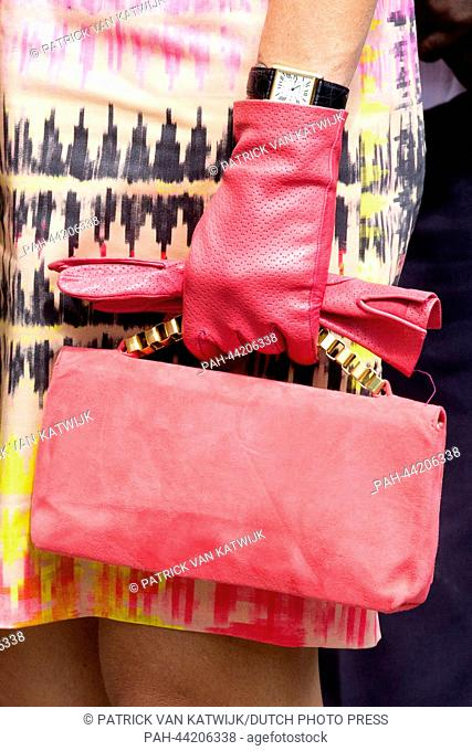 Dutch Queen Maxima of the Netherlands carries a red handbag as she arrives at Westpunt on the Caribbean island of Curacao, Netherlands, 19 November 2013