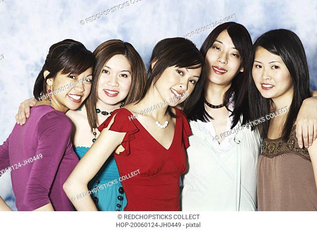 Portrait of five young women smiling
