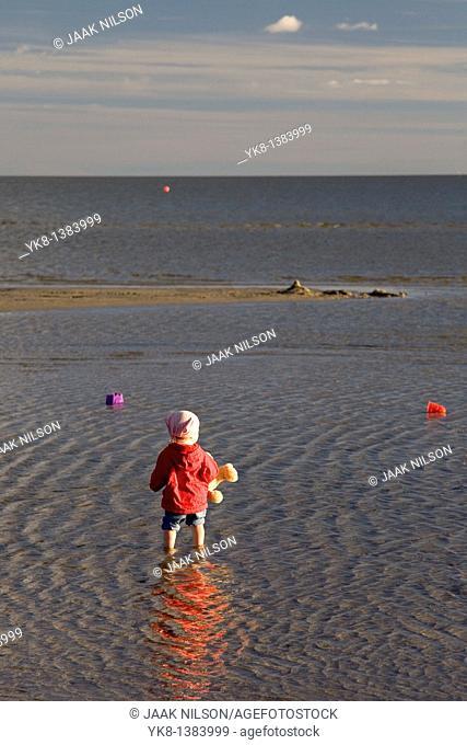 Kid in Water on Pärnu Beach, Estonia, Europe