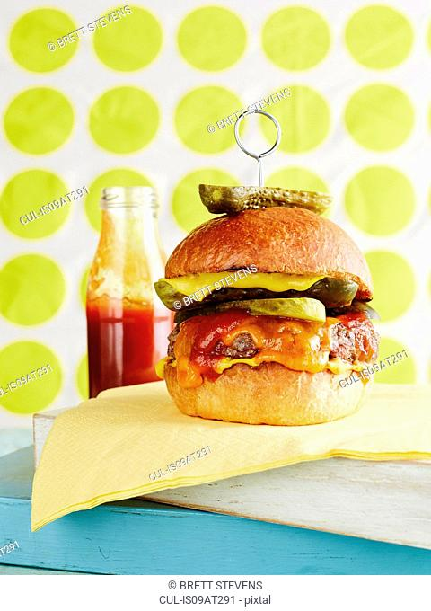 Still life of cheeseburger with retro background