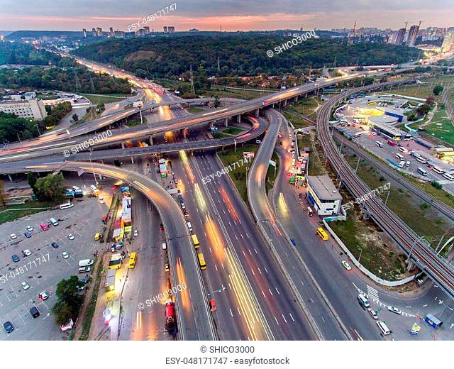 Traffic on freeway interchange. Aerial night view city traffic
