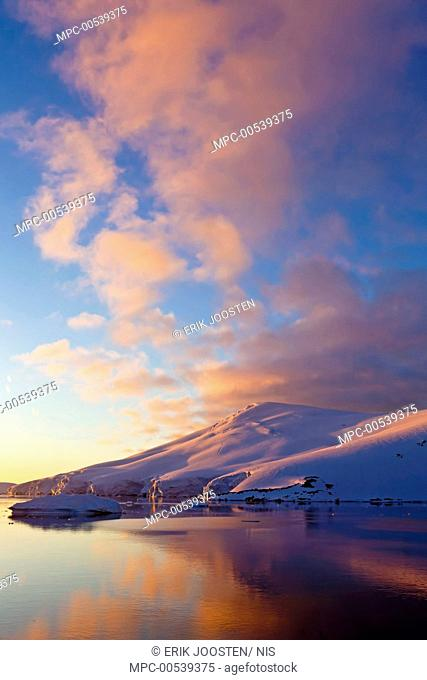Sunset over coastal mountains, Lemaire Channel, Antarctica