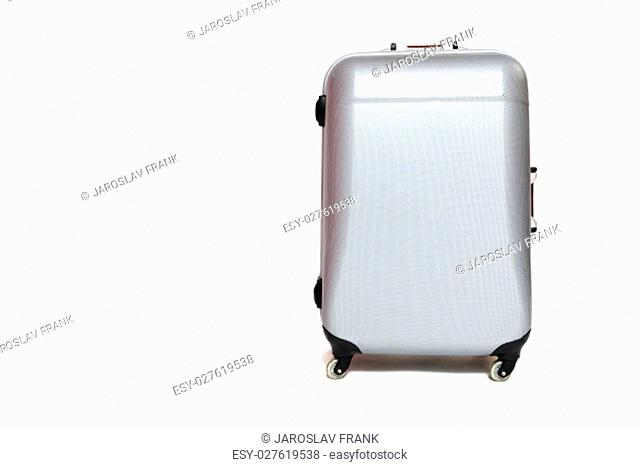 Front view of the silver shell suitcase standing on the white background