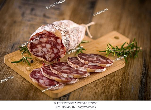 French salami Sausage on a wooden table, France