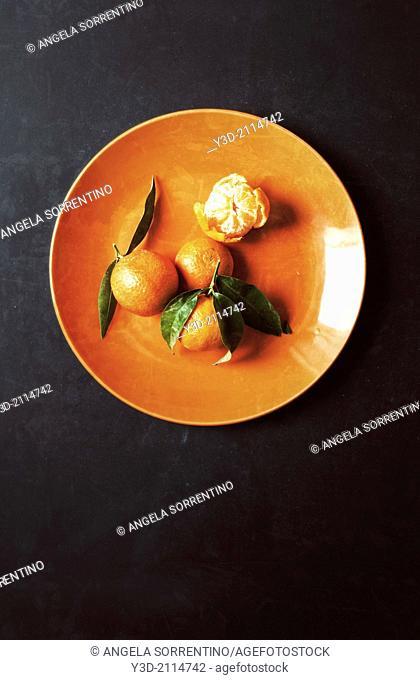 Tangerine on orange dish