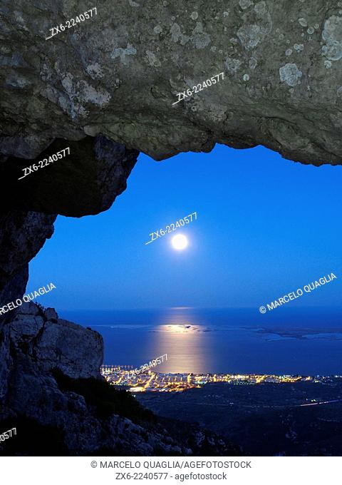 Rising full moon over Alfacs Bay seen from La Foradada Peak at Montsia Hills. Ebro River Delta Natural Park, Tarragona province, Catalonia, Spain