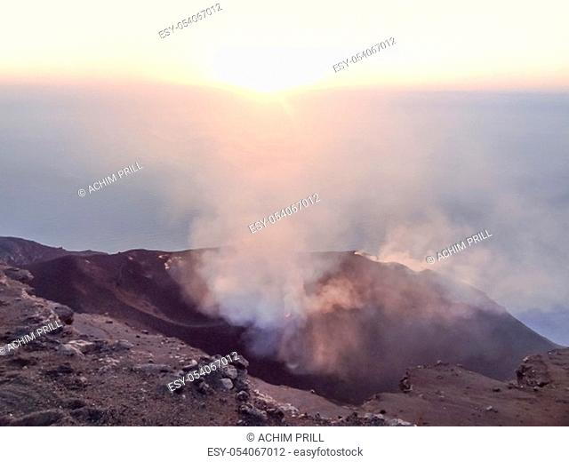 smoky crater scenery at Stromboli volcano near Sicily at evening time
