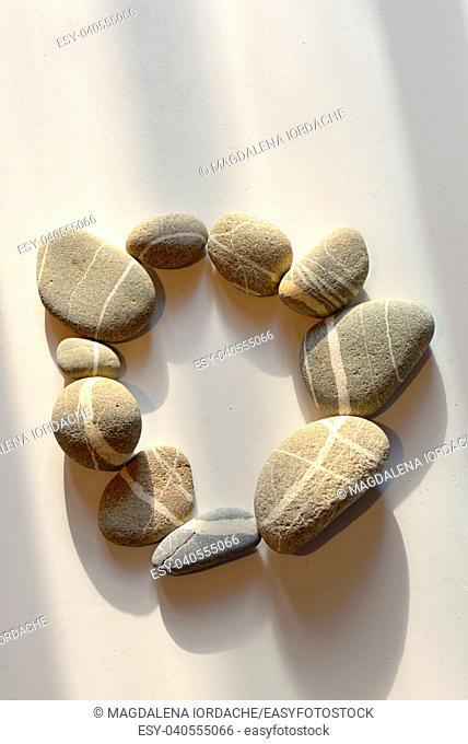 pebble stones circle on white background