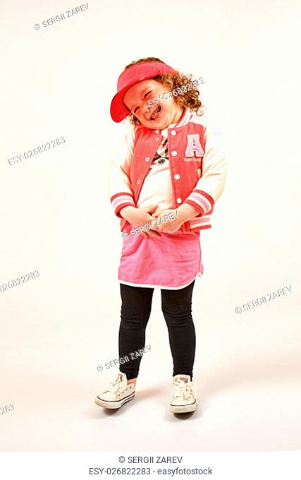 Little girl with red cap standing and smiling