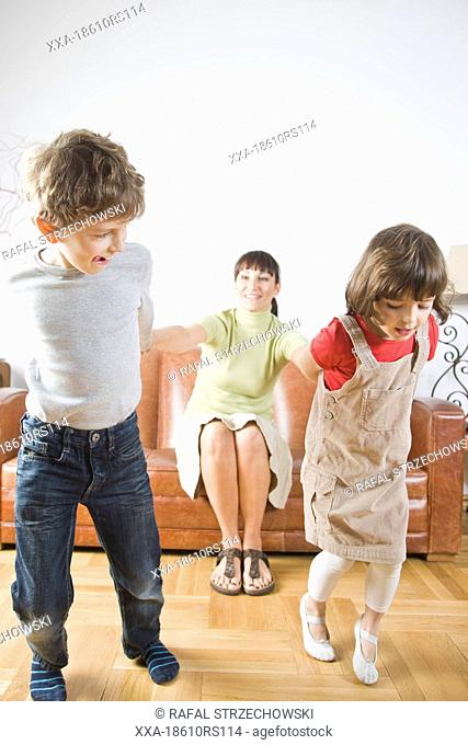 children playing with mum
